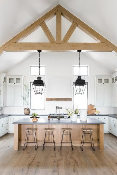 light wood kitchen floors in A-frame space by Studio McGee