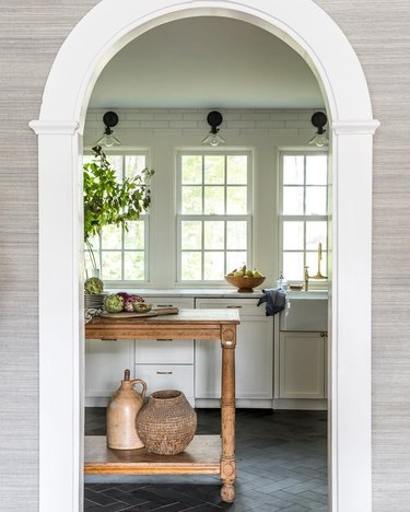 white kitchen dark floors with stone kitchen floors with white cabinets and wood island