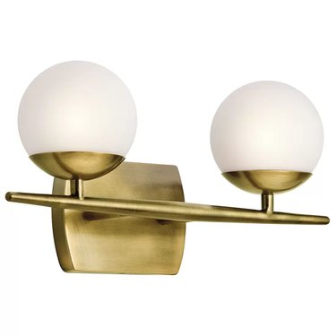 Brass sconce with two white globes joined by brass bar