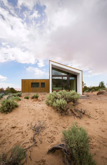 Desert style home with modern design elements and sloped roof