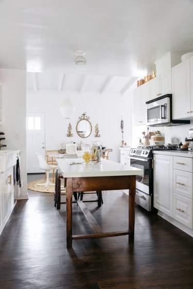 Dark wood kitchen flooring idea with wood table and vintage decor