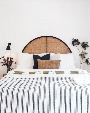 desert themed bedroom with curved rattan bed