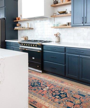desert themed kitchen with blue cabinets and tile backsplash