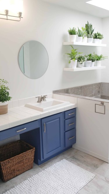 Painted bathroom cabinets before and after featuring modern details and blue cabinets
