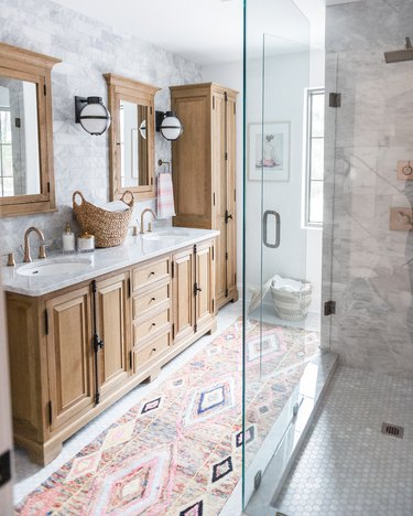 Double bathroom vanity with undermount sinks and bohemian decor