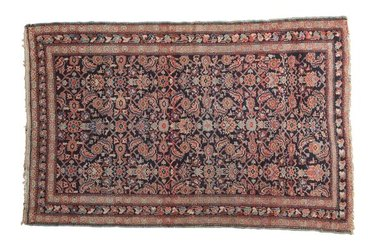 Traditional variegated rug, navy and red dominant