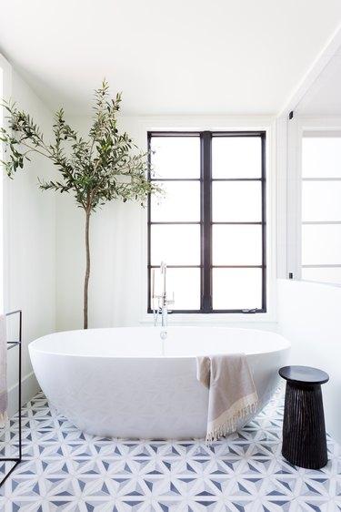 A freestanding bath tub in the master bath
