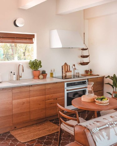 Desert-Themed Kitchen with wood cabinets and tile floor by Joshua Tree House