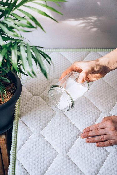 Deodorizing a mattress with a DIY cleaner.
