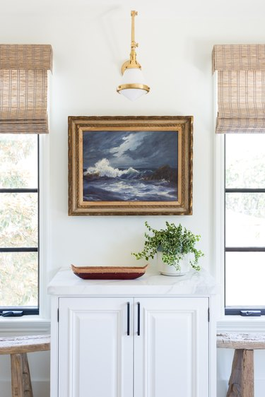 A vintage painting in the kitchen