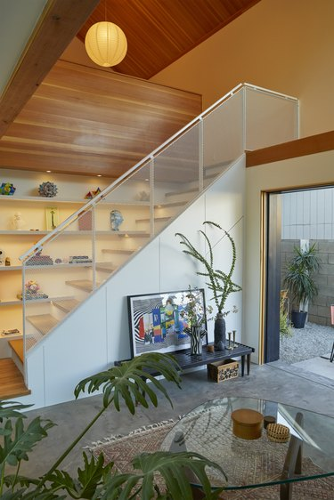 open concept living room with minimalist staircase