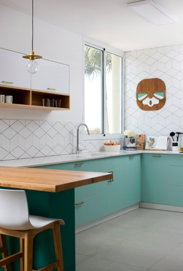 modern kitchen with light green cabinets