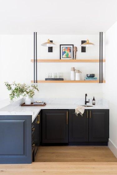 The bar area with dark cabinets and a custom shelf