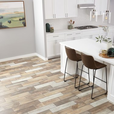 kitchen space with white cabinets and multicolored porcelain tile floor
