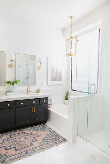 Painted bathroom cabinets before and after featuring white, modern bath and black cabinets