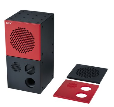 speaker with red top half and two accessories in ed and balck nearby