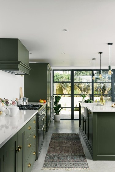 traditional kitchen with green cabinets