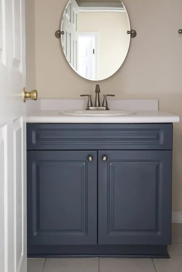 Painted bathroom cabinets before and after featuring blue vanity