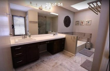 Painted bathroom cabinets before and after featuring dated decor and double vanity