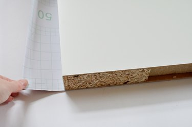 close up of white shelf resting on contact paper backing