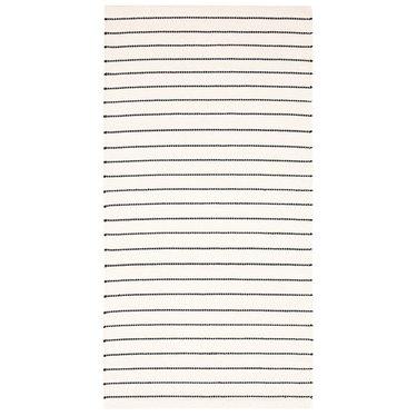 Black and white IKEA Scandinavian rug with stripe design