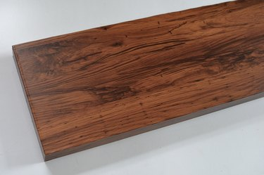 white shelf now covered in dark brown walnut contact paper