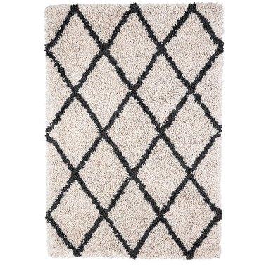 Black and white Scandinavian rug with graphic diamond design