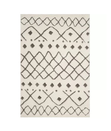Cream Scandinavian rug with linear details and shapes