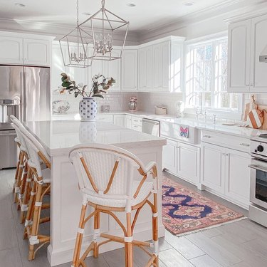 navy and pink rug for kitchen floor in all-white traditional kitchen