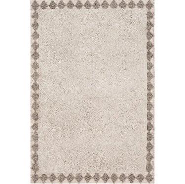 Cream Scandinavian rug with graphic border