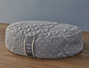 circular gray meditation and yoga pillow