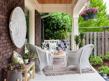Craftsman front porch with wicker chairs and bohemian decor