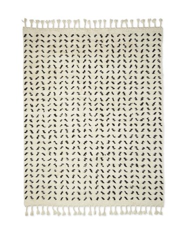 Black and white Scandinavian rug with tassels and graphic designs