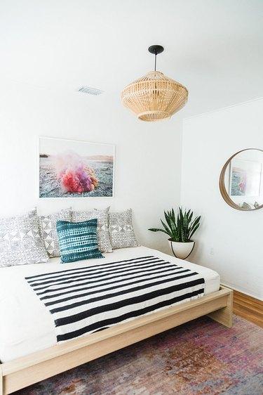 white Scandinavian boho bedroom with boho accents