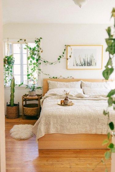 Scandinavian boho bedroom with natural greenery
