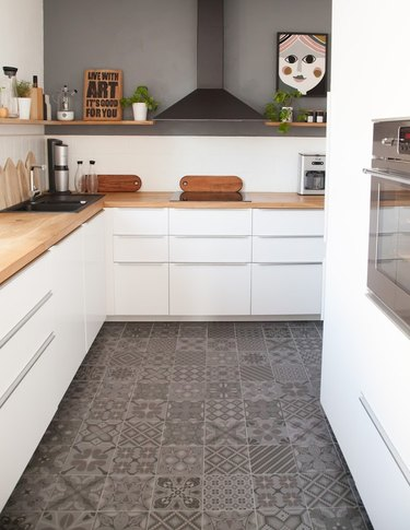 white and gray kitchen with gray encaustic tiles