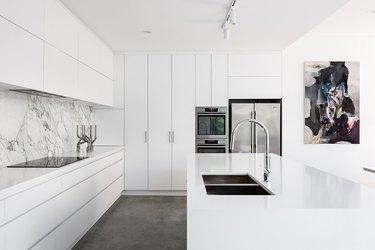minimal white kitchen with dark gray floor