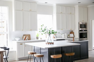 l-shaped kitchen island with navy blue details