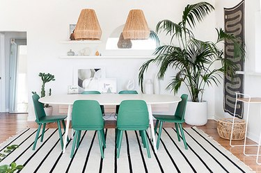 white Scandinavian boho dining room with green chairs