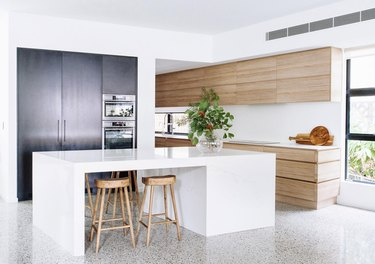 white and oak modern with gray terrazzo floor.