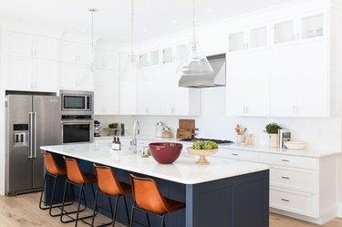 white kitchen cabinets with blue kitchen island