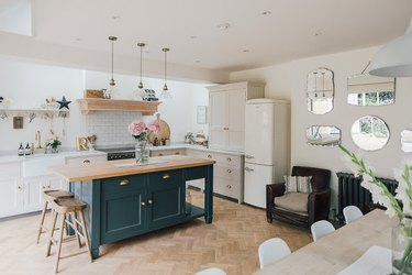 dark blue grey kitchen island with wooden countertop