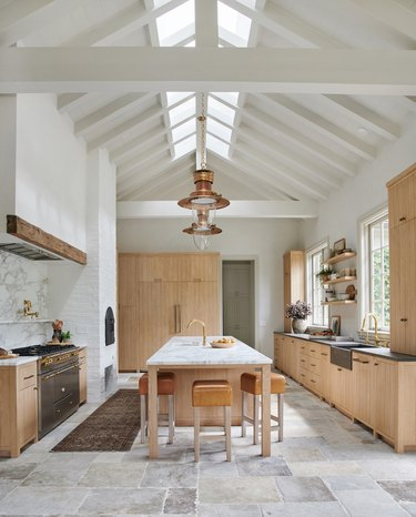 country farmhouse kitchen with natural stone flooring