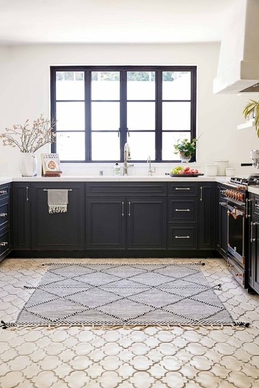 rug for kitchen floor with Moroccan tile and black cabinets