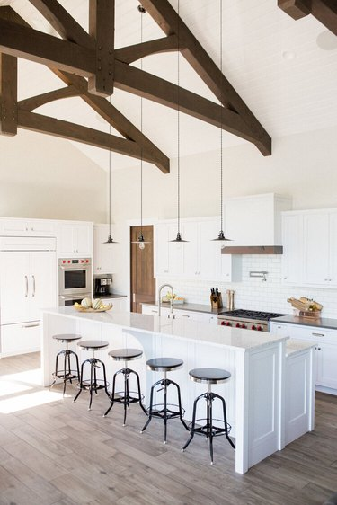 two tier kitchen island with white countertop and white base