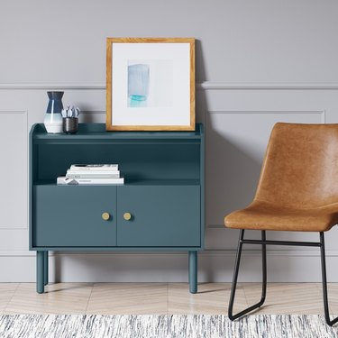 blue two-door accent chest with gold hardware