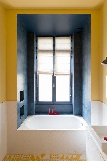 yellow bathroom with built-in bathtub