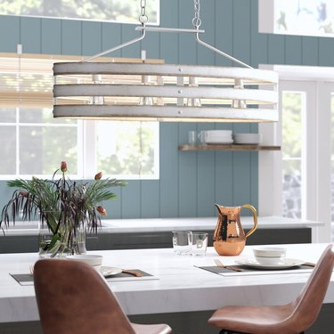 wood chandelier with distressed white finish