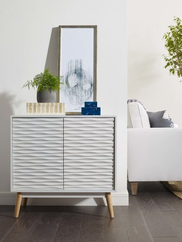 white accent chest with textured doors