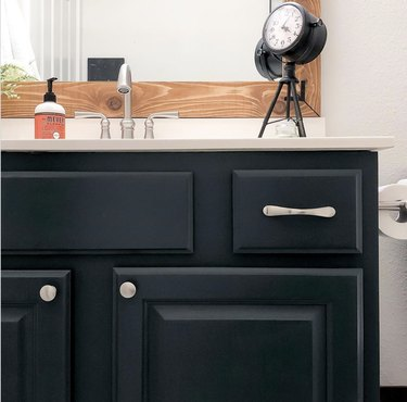 DIY bathroom vanity repainted dark blue-gray